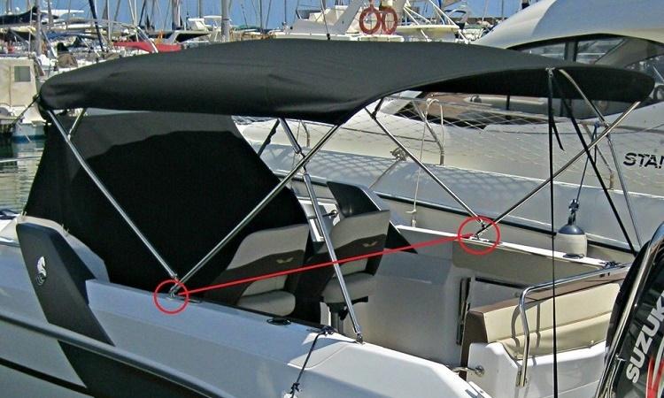 Instalación de toldo en barco de fibra